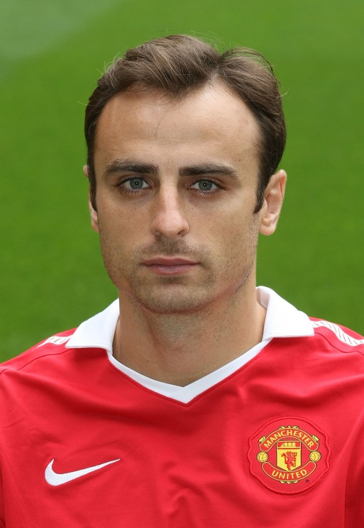 MANCHESTER, ENGLAND - AUGUST 13: Dimitar Berbatov of Manchester United poses at the annual club photocall at Old Trafford on August 13, 2010 in Manchester, England. (Photo by John Peters/Man Utd via Getty Images)